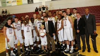 Mims Records 500th Victory in 64-54 Win